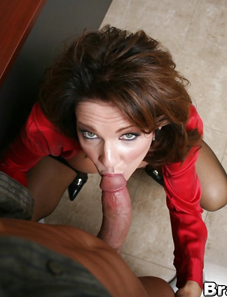 Big breasted brunette MILF wench moans loudly while she swallows a big stiff meat rod