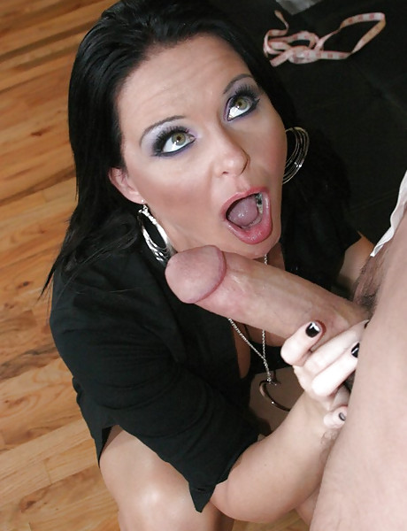 Foxy brunette bitch takes her sexy black lingerie off and sucks big fat dong