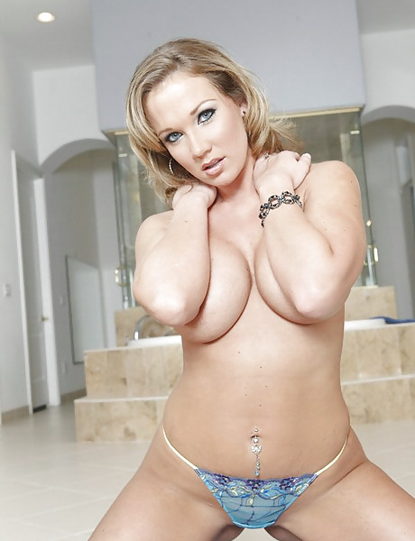 Big breasted blonde hottie takes her lingerie off and fucks with her hung lover