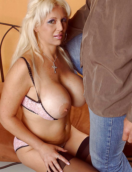 Big breasted blonde whore strips her black lingerie and gets nailed hard and fast