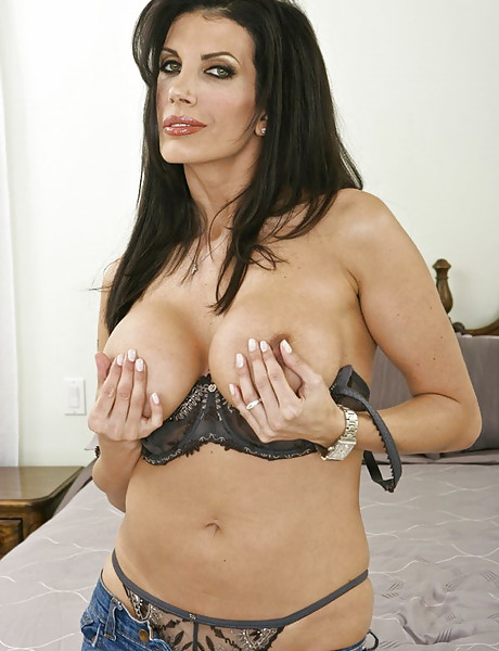 Foxy busty brunette MILF takes her sexy black lingerie off and sucks big hard cock