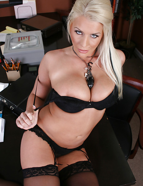 Slutty and classy blonde MILF strips in the office and fucks in black stockings