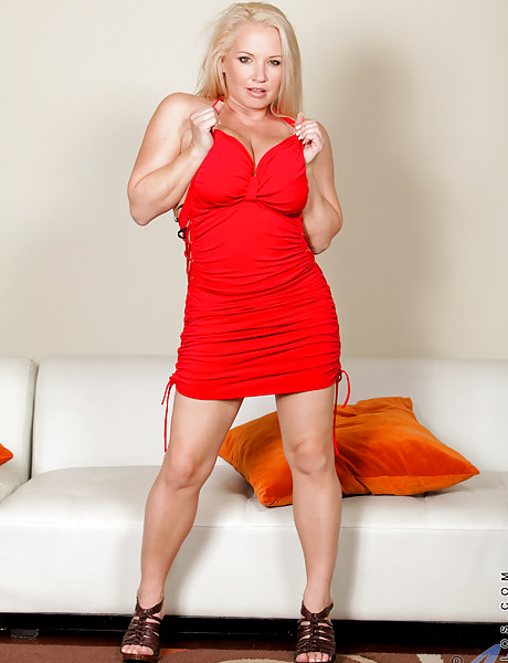 Busty blonde MILF lady takes her tight red dress off and shows us her big jugs
