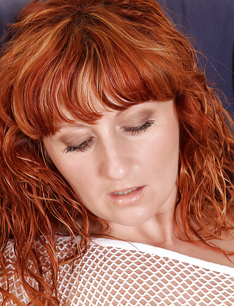 Horny redhead mature whore takes her lingerie off and toys her gaping hungry muff