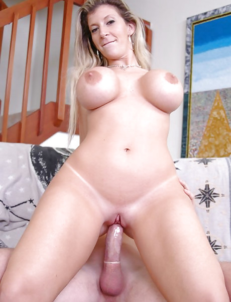 Busty blonde MILF lady takes her pink lingerie off and rides a big hard schlong.