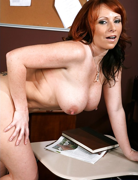 Slutty redhead MILF babe spreads her legs and gets her muff rammed hard and fast.