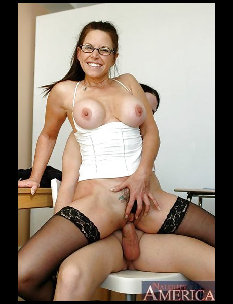 Classy brunette MILF bitch takes her white corset off and fucks in black stockings.