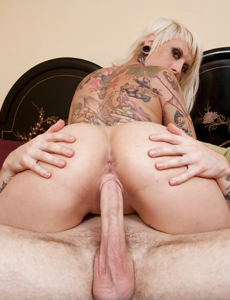 Tattooed blonde slujt takes her clothes off and gets smashed by massive hard cock.