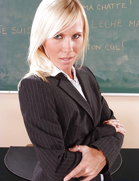 Classy mature teacher strips in the classroom and has wild sex with her student.