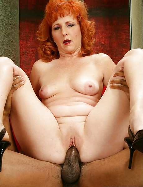 Classy redhead mature lady spreads her legs and gets nailed by big black cock.