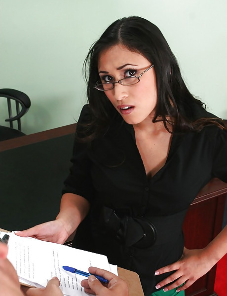 Foxy and classy brunette babe takes her clothes off in the office and sucks hard cock