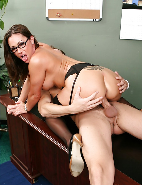 Classy MILF teacher strips for her student and gets fucked in black lingeriew.