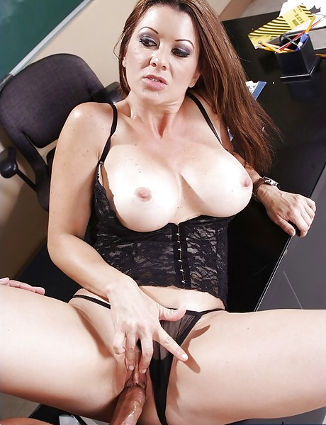Classy MILF teacher seduces a handsome student and rides his hard cock in lingerie.