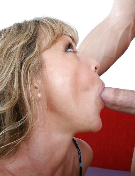 Foxy blonde mature vixen takes her blue dress off and rides a big hard cock.