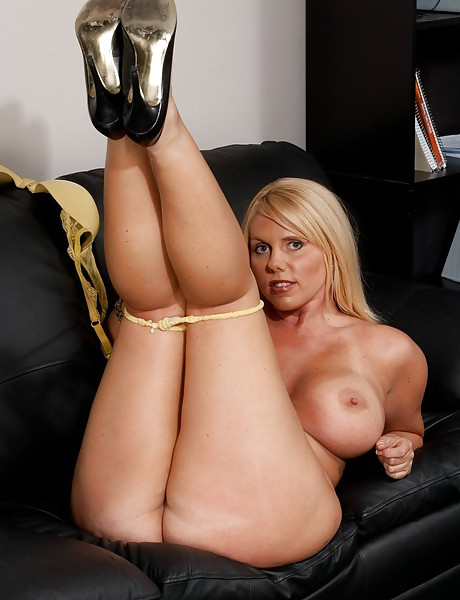 Smoking hot blonde MILF takes her dress off on the sofa and gets fucked from behind.