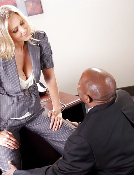 Big breasted blonde babe strips her clothes in the office and rides a big black cock.