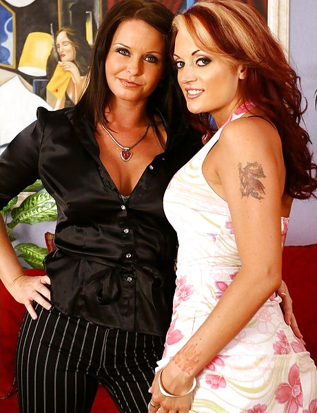 Classy MILF bitches take their classy outfits off and share a big cock on the sofa.