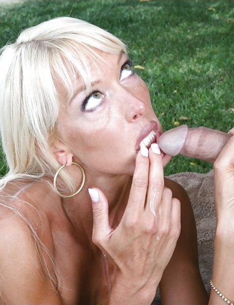 Beautiful busty blonde takes her black bikini off outdoors and rides a big hard dong.