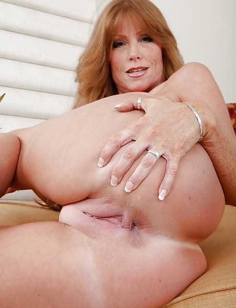 Busty redhead MILF bitch takes her dress off and rides a massive hard boner.