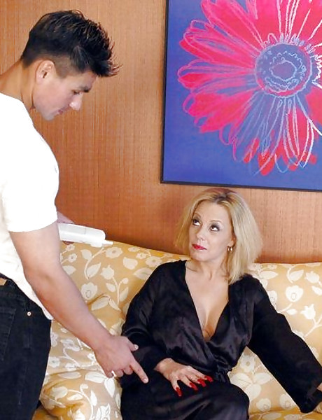 Foxy blonde angel takes her black dress off and gets her muff rammed hard on the bed.