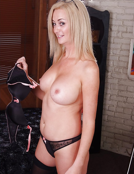Classy busty blonde babe takes her clothes off and fucks hard in black stockings.