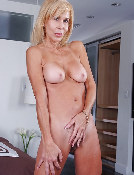 Seductive classy blonde mature lady strips her pink dress and gets fucked hard.
