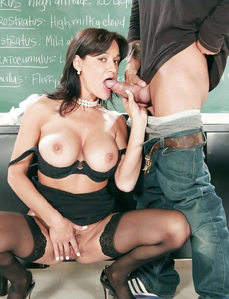 Classy brunette teacher strips in the classroom and fucks in black stockings.