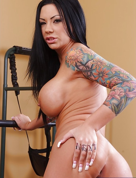 Busty tattooed brunette babe takes her clothes off and fucks a tattooed hunk.