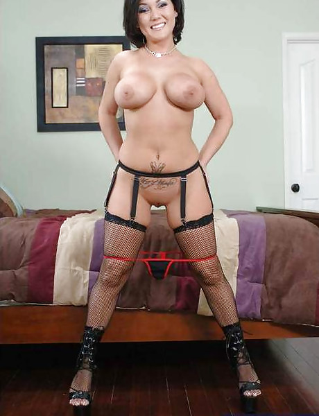Classy brunette MILF takes her red corset off and fucks in sexy black stockings.