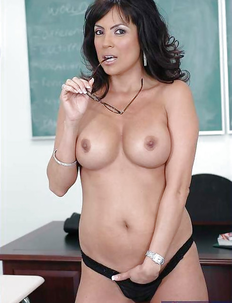 Classy brunette office lady takes her black outfit off and slurps on hard fat prick.