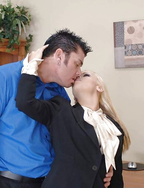Classy blonde office MILF takes her clothes off and fucks in black stockings.