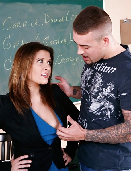 Smoking hot classy MILF teacher seduces her tattooed student and gets fucked hard.