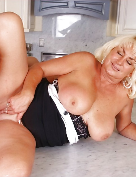 Big breasted blonde granny takes her tight dress off and fucks with younger stud.