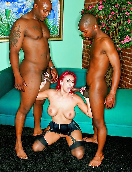Slutty redhead MILF slut takes her pink dress off and fucks two big black cocks.