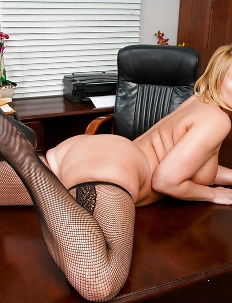 Classy busty MILF slut seduces a coworker and gets fucked in black stockings.