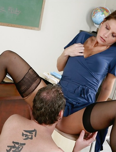 Alluring blonde teacher seduces her tattooed student and fucks in black stockings.