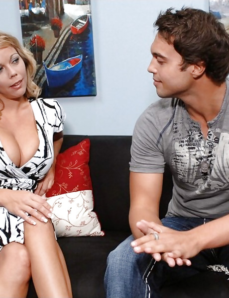 Busty blonde MILF bitch takes her clothes off on the sofa and fucks with a hunk.