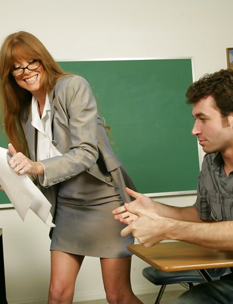 Classy mature teacher strips for her student and lets him fuck her on the sofa.