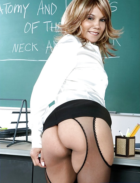 Classy blonde teacher seduces her student and fucks his cock in sexy black lingerie.