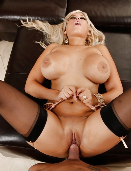 Classy big breasted blonde babe strips her lingerie and fucks in black stockings.