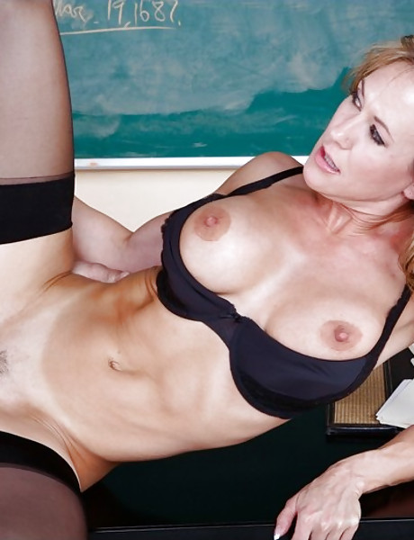 Classy blonde MILF teacher takes her black stockings off and fucks in the classroom.