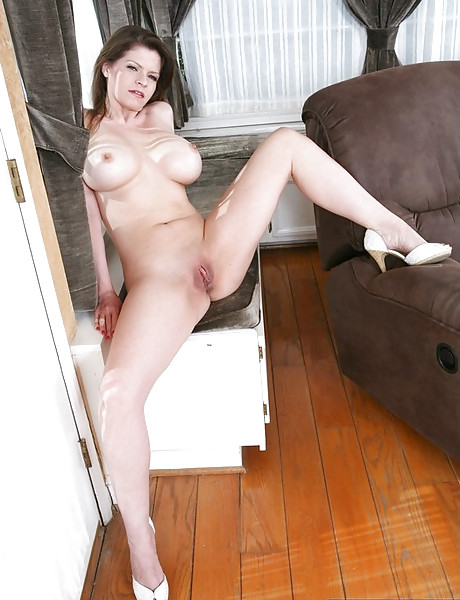 Beautiful mature vixen strips her clothes on the sofa and gets fucked by hard shaft.