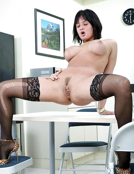Classy mature lady slowly strips in the office and fucks in expensive black lingerie.