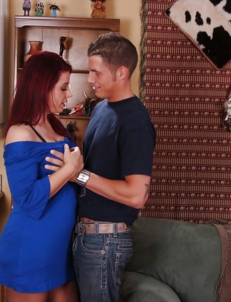 Fuckable busty redhead MILF screams hard as she gets nailed in black stockings.