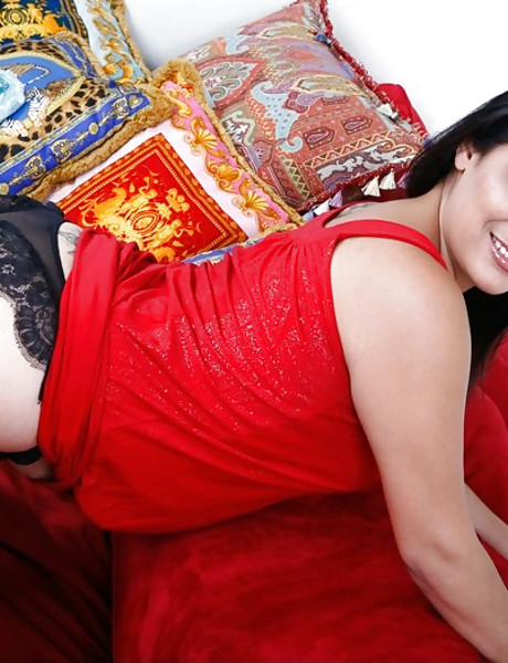 Attractive brunette vixen takes her red dress off and rides on massive hard cock.