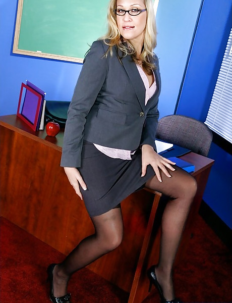 Classy blonde office lady takes her clothes off and fucks hard in black stockings.