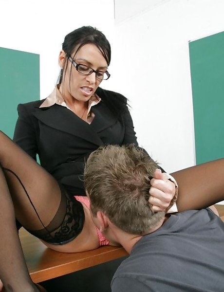 Seductive classy brunette teacher strips and then fucks a student in black stockings.