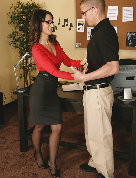 Classy office MILF seduces her younger coworker and fucks in black stockings.