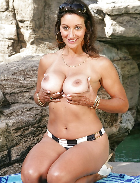 Busty mature vixen takes her bikini off outdoors and fucks with random dude.