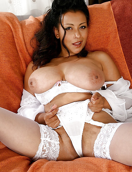Seductive tanned brunette with big boobies wearing white underwear fingering her twat